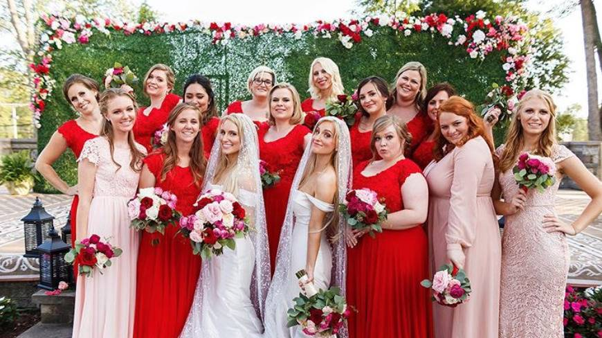 Briana and Brittany pose with their bridal parties.
