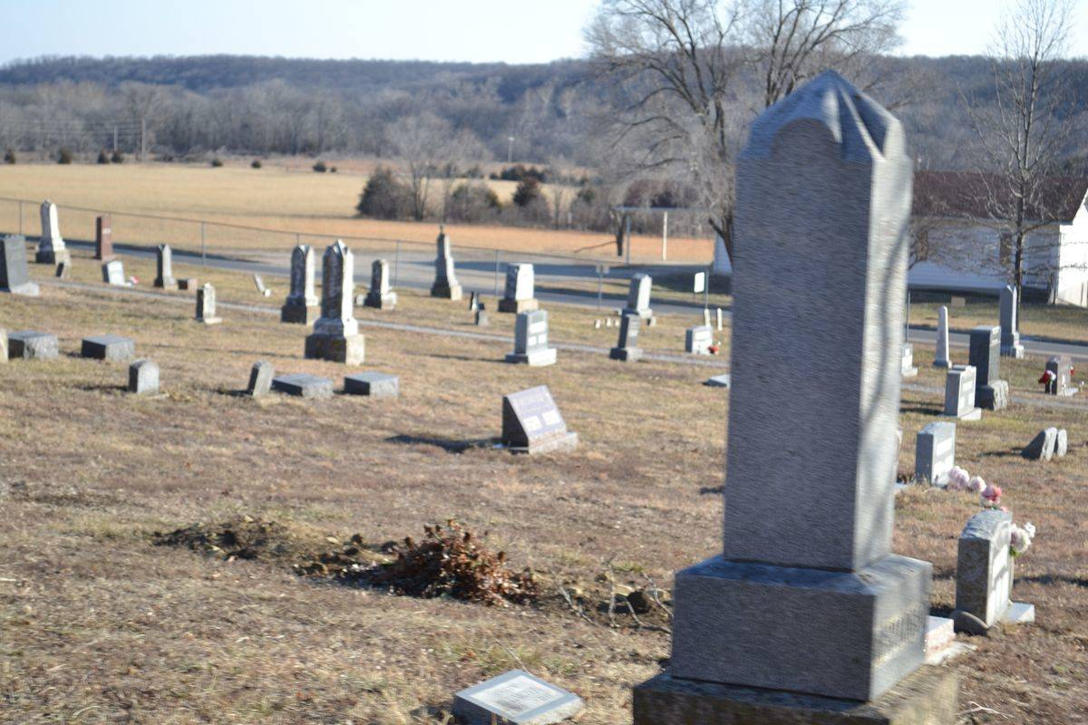A photo shows the headstones at Stull Cemetery.