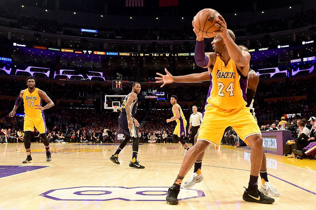 Kobe Bryant #24 of the Los Angeles Lakers with the ball against the Utah Jazz