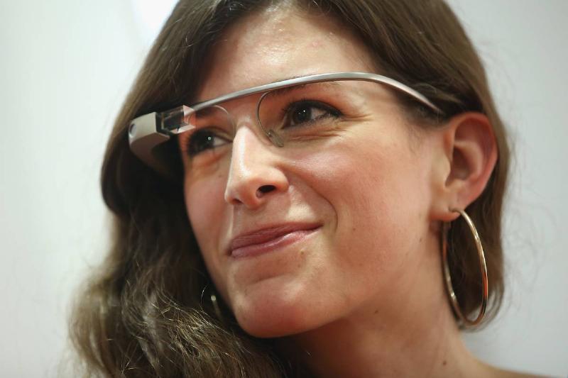 A woman wears Google glass.
