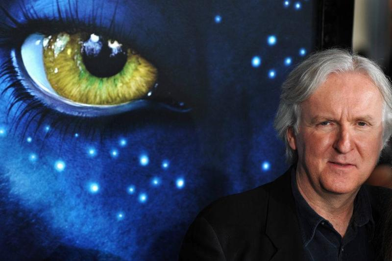 james cameron in front of an avatar poster