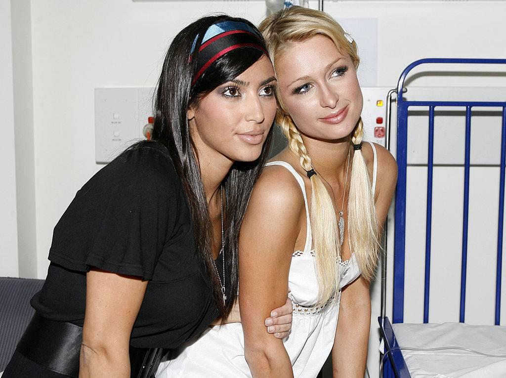 kim kardashian and paris hilton posing for a photo