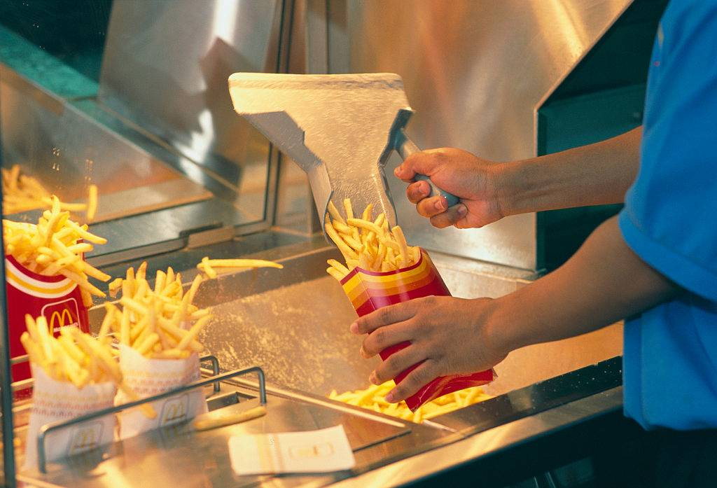Person serving fries