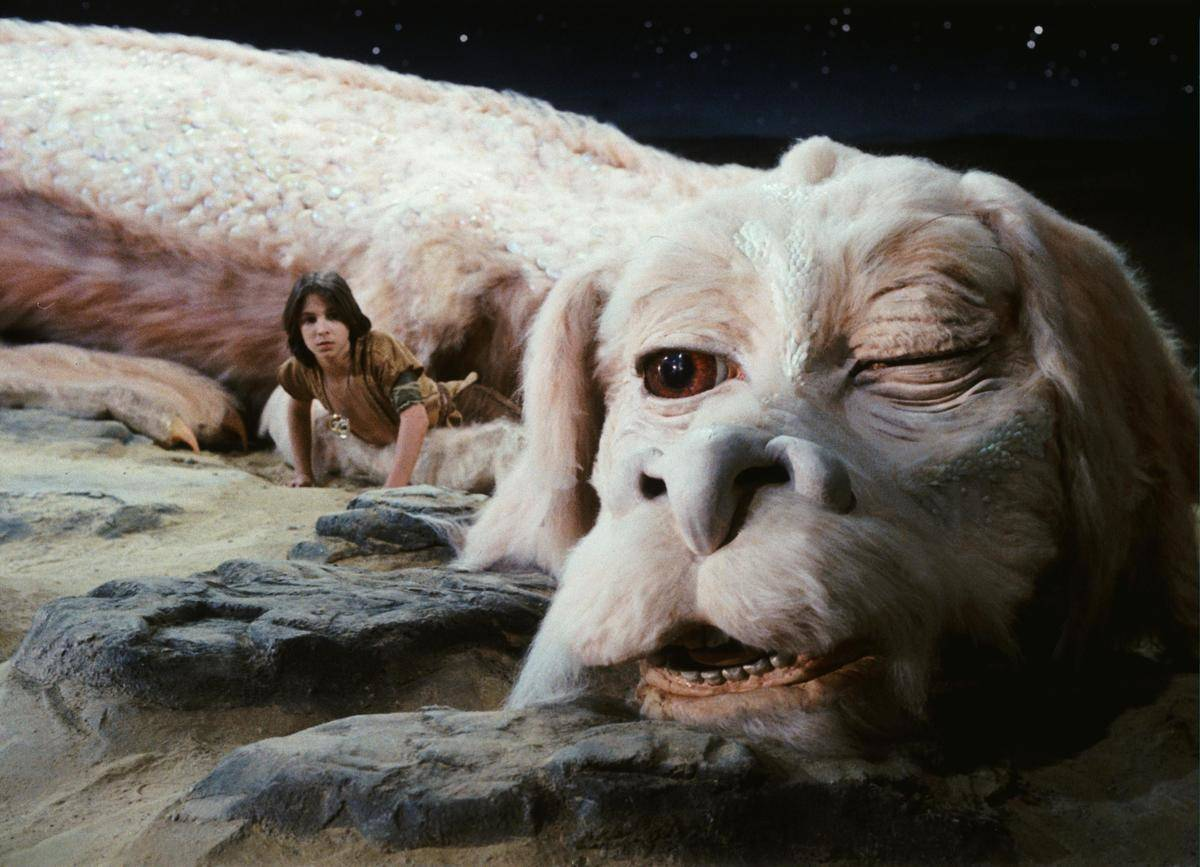 a boy and mythical creature in the neverending story
