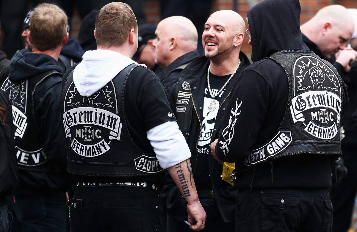 Members of the German biker club, Gremium, gather to chat.