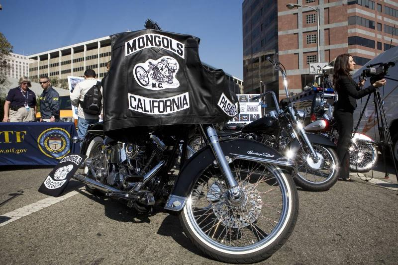 A Mongols motorcycle club jacket is draped over a bike.