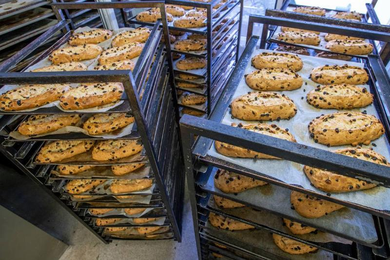 Use A File Organizer To Neatly Stack Baking Sheets