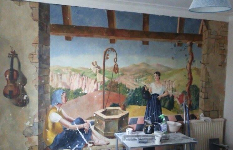Vintage art is seen underneath a wall.