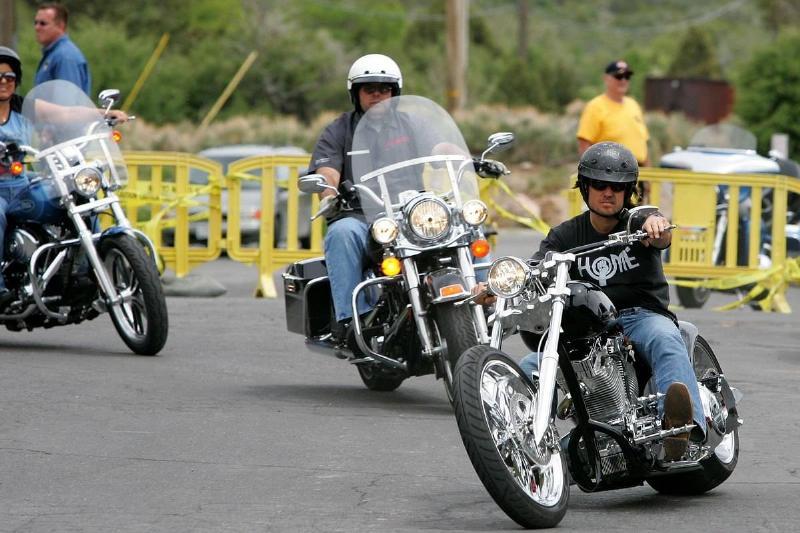 Men drive around on motorcycles.