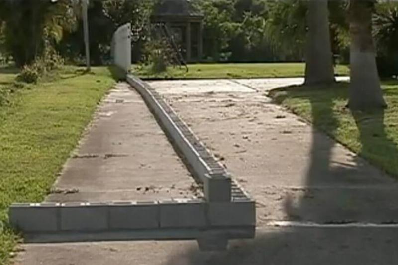 Cinder blocks obstruct Oliver Lynch's driveway.
