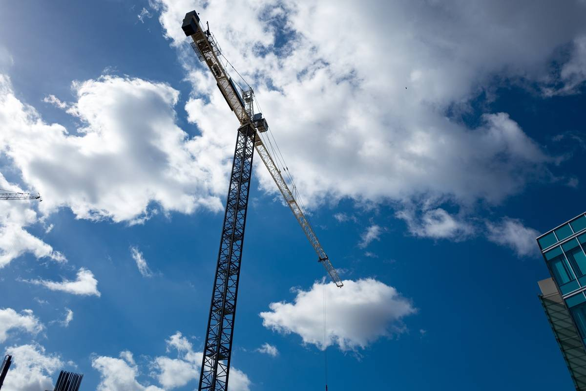 A crane appears against the clouds.