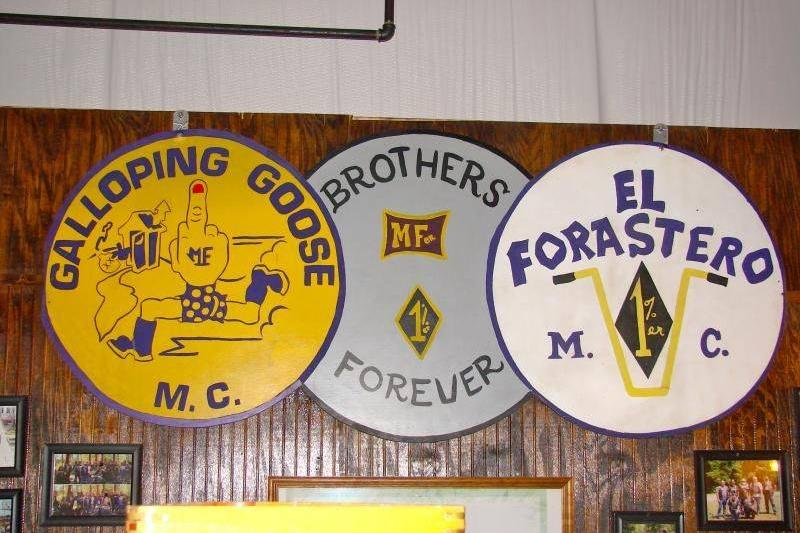 Signs featuring the Galloping Goose logos and insignias line a wall.