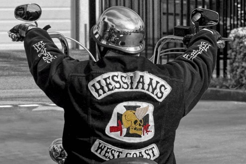 A member of the Hessians rides a motorcycle.