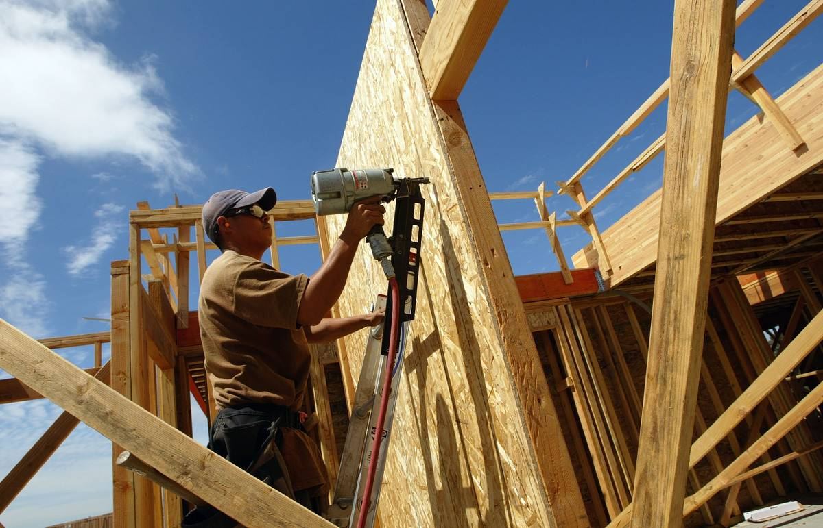 A construction worker builds a house.