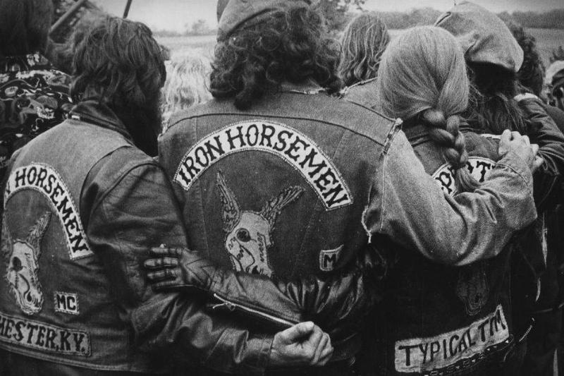 Members of the Iron Horsemen motorcycle club wrap their arms around each other.