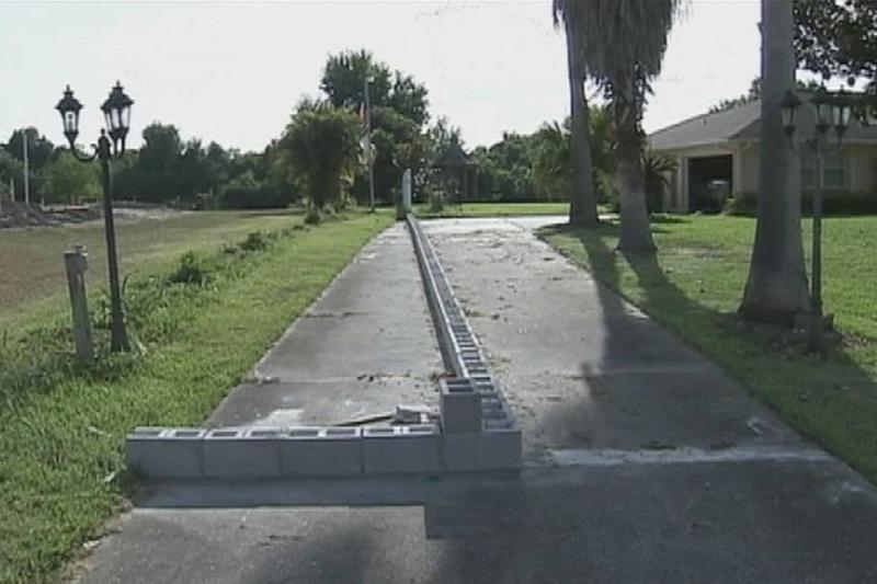 A corner of cinder blocks cross Lynch's driveway.
