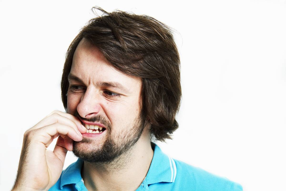 A man bites his nails.