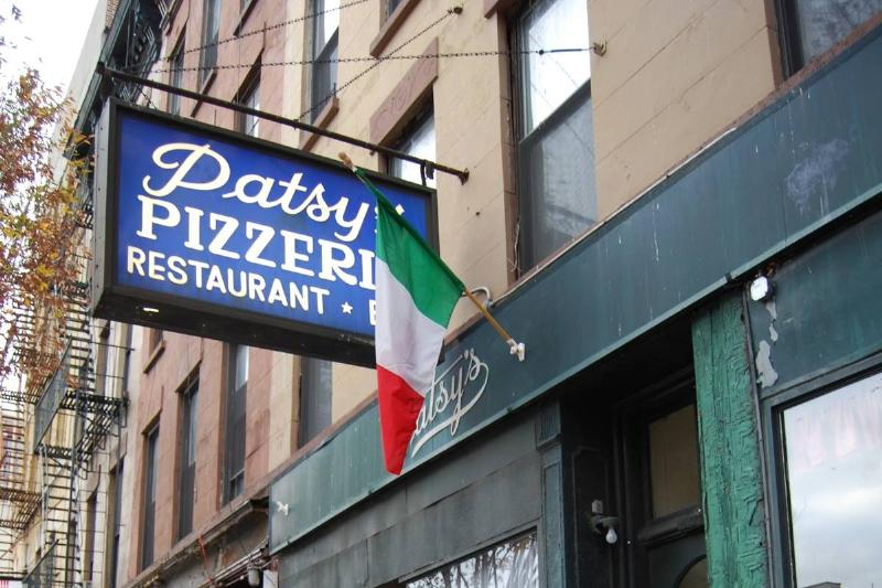 A photo shows the exterior of Patsy's Pizzeria.