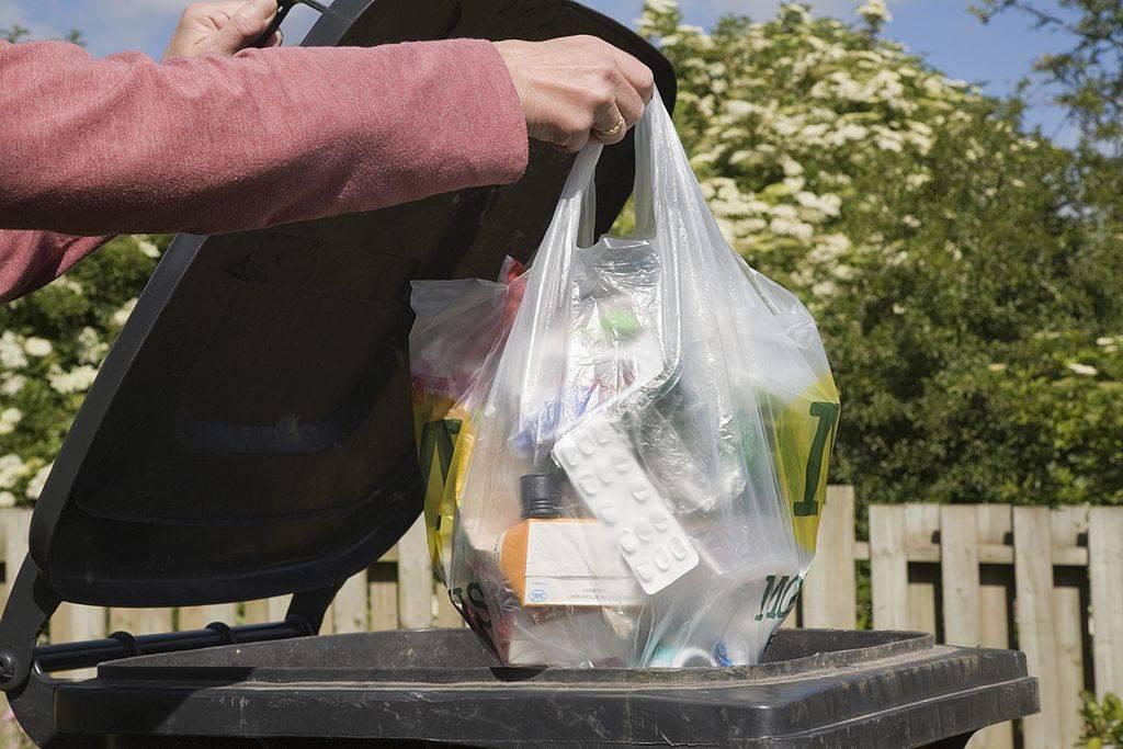 Woman throwing away trash