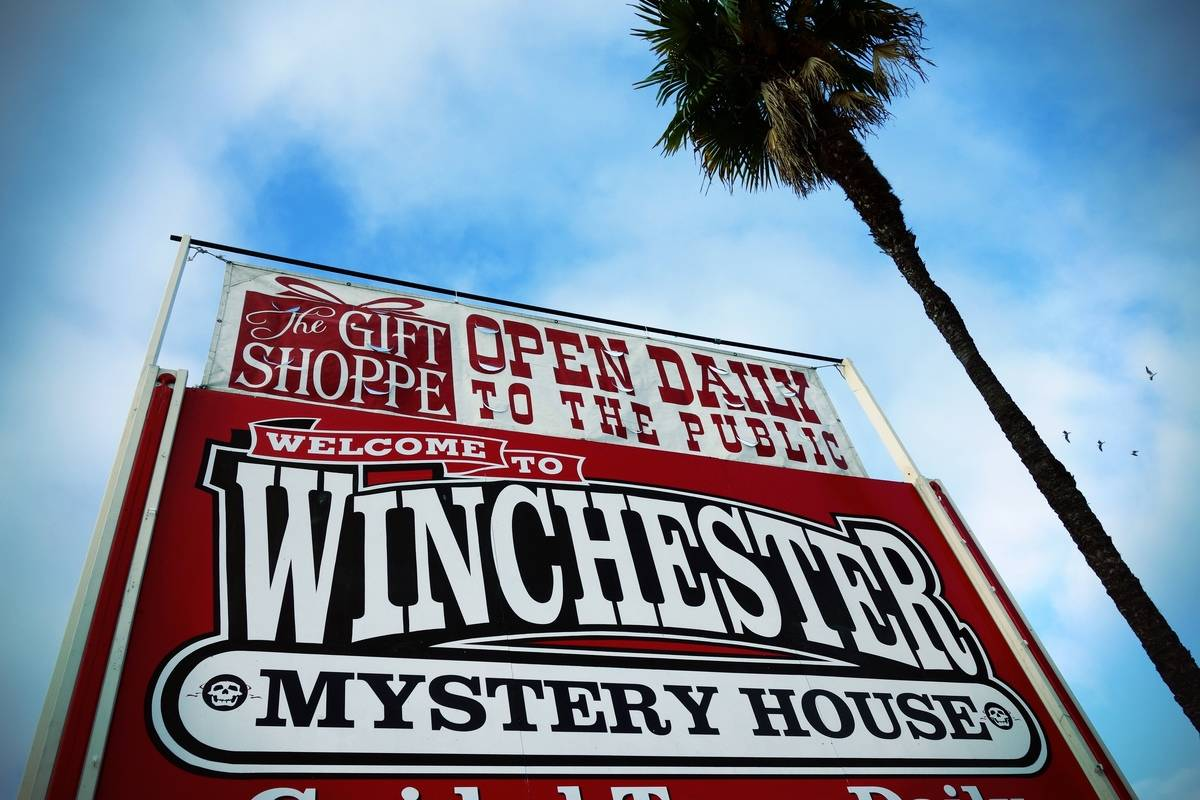 A sign points to the Winchester Mystery House.