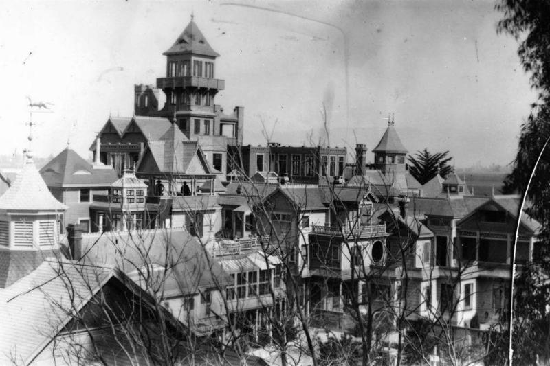 A photo shows what the Winchester mansion looked like in the early 1900s.