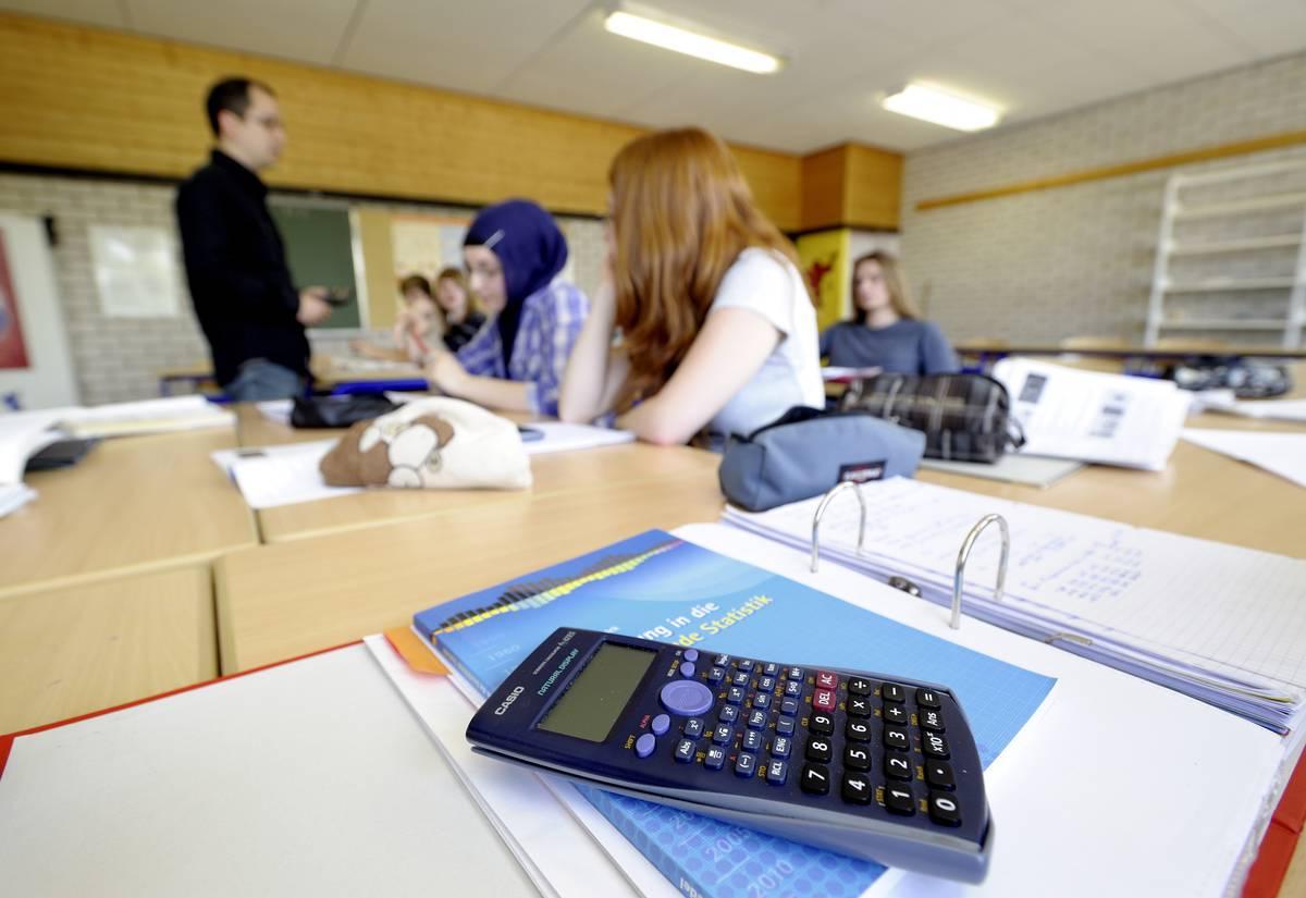 A teacher teaching mathematics in a High School
