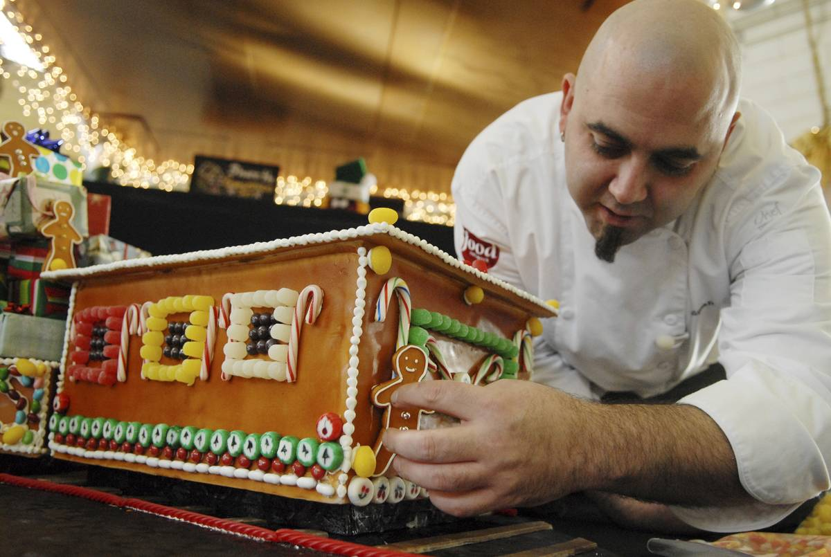 Duff Goldman decorates a cake on