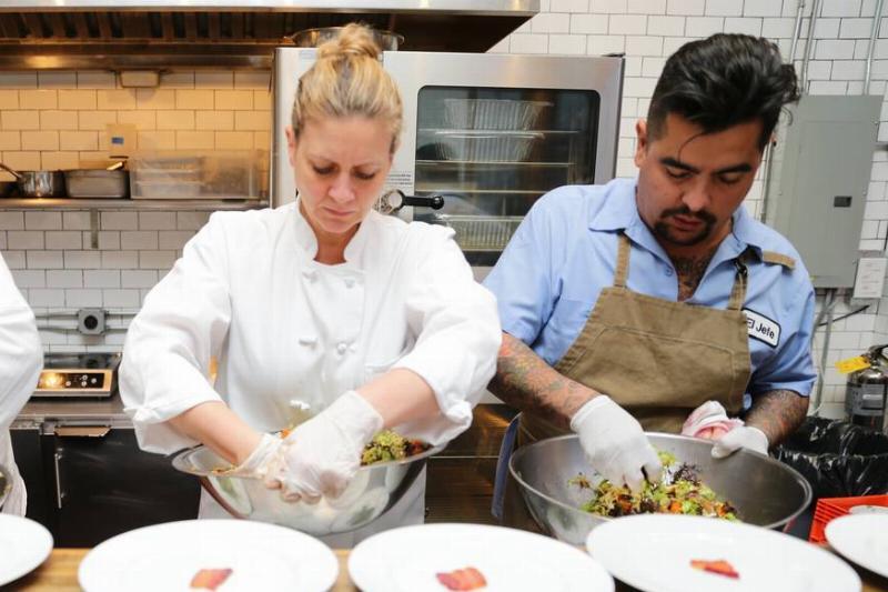 Chefs Amanda Freitag and Aaron Sanchez prepare dinner.
