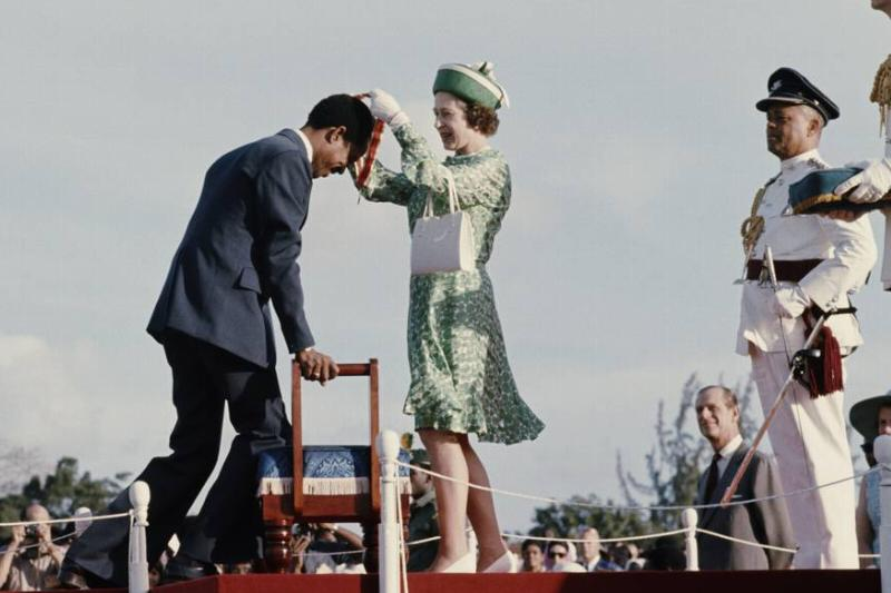 West Indian cricketer Garfield Sobers receives a knighthood from Queen Elizabeth II.