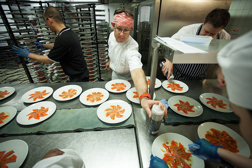 Chef Shaun Presland plating up food in the kitchen