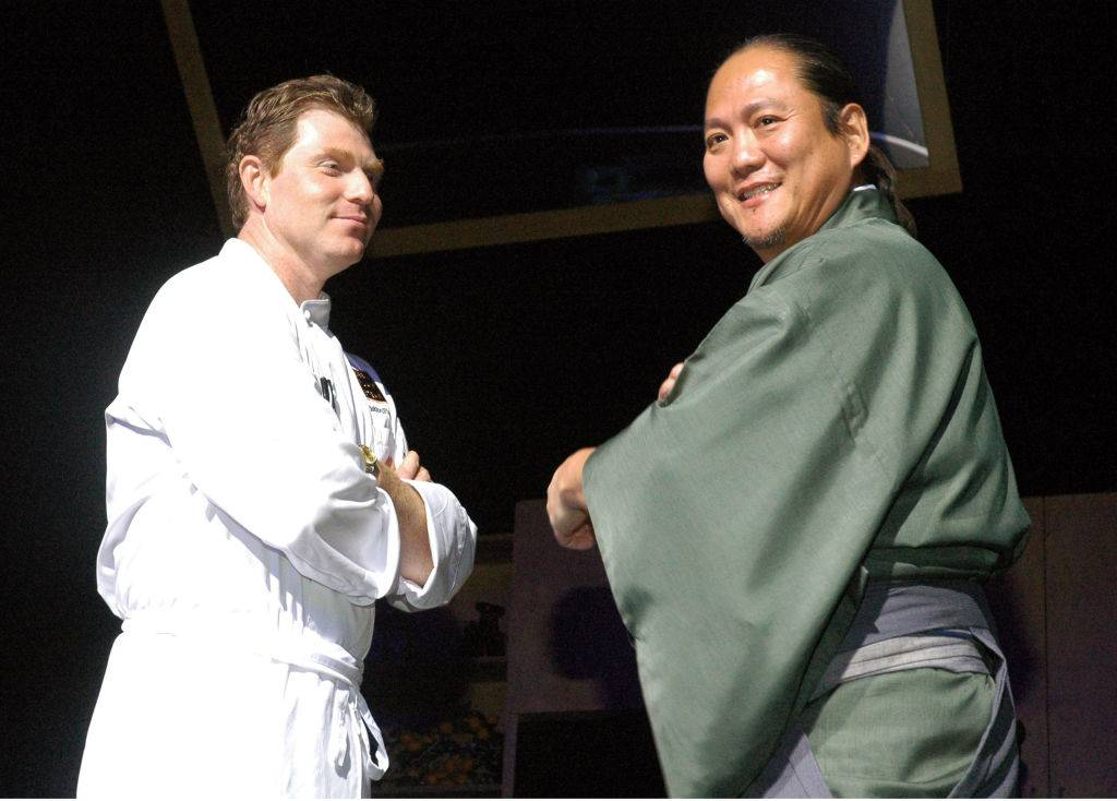 Bobby Flay and Masaharu Morimoto posing for a photo with their arms crossed