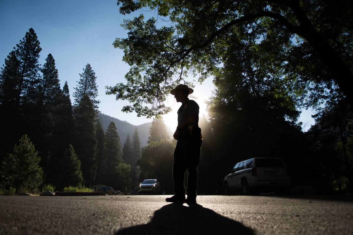 A national park ranger directs parking.
