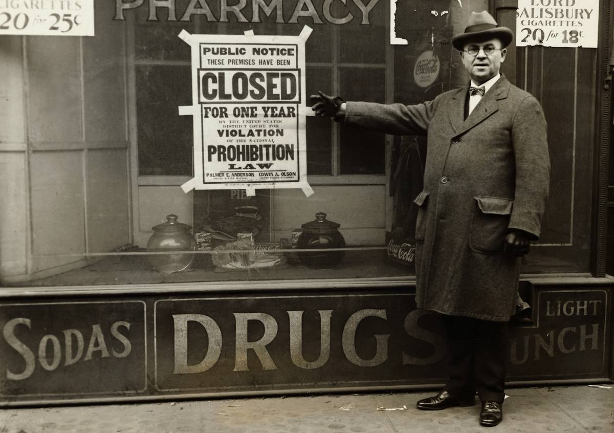 Man Points to Prohibition Sign