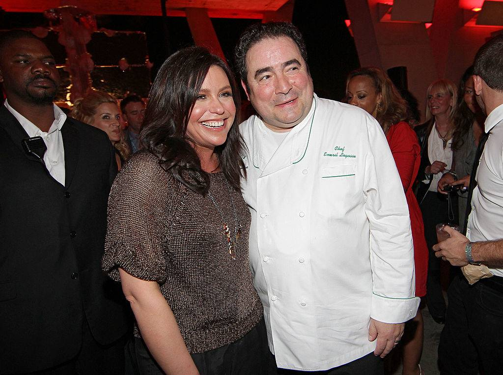 Rachael Ray and Emeril Lagasse posing for a photo
