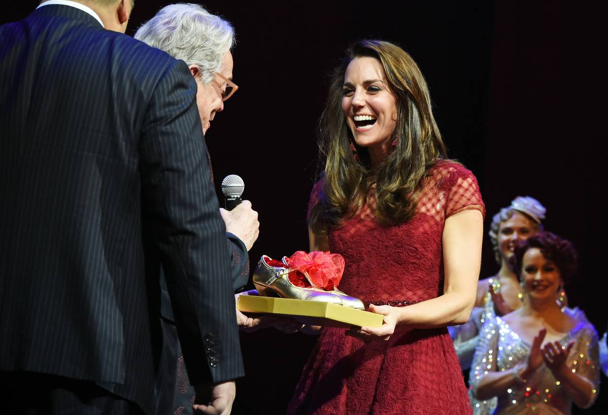 Catherine, Duchess of Cambridge, accepts a gift of tap shoes from producer Michael Linnet.