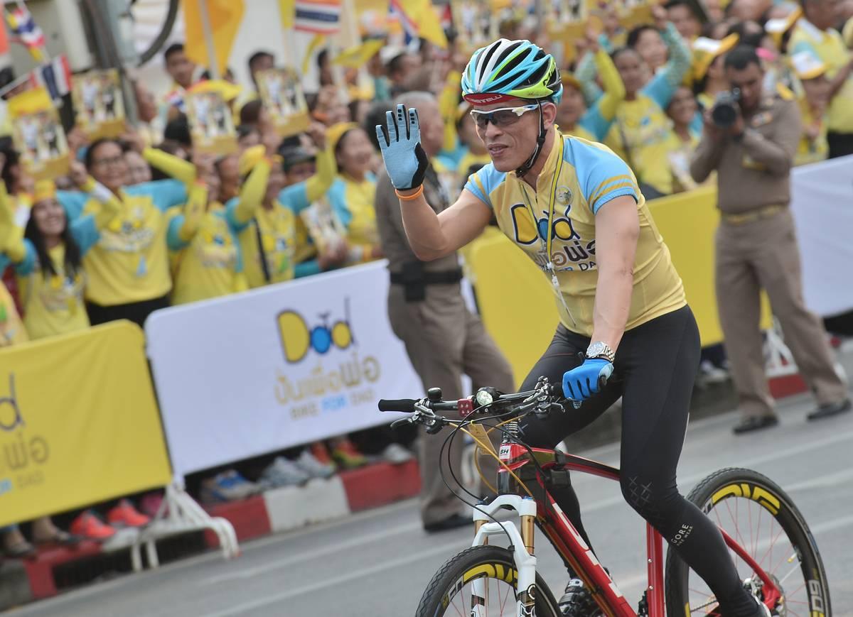 Thailand Crown Prince, Maha Vajiralongkorn cycles during the cycling event 'Bike for Dad' in Bangkok.