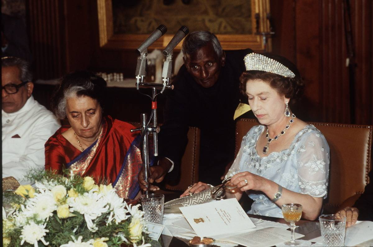 While visiting India, the Queen prepares a speech during a banquet with Mrs Gandhi.