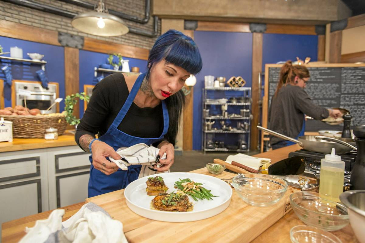 Contestant Amber Brauner perpares her plate for review as seen on Food Network's Worst Cooks in America, Season 5.