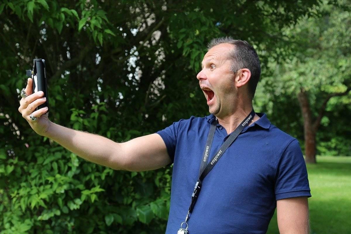 A man yells at his phone.