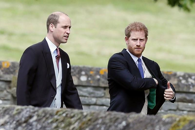 Princes William and Harry arrive at the wedding of Pippa Middleton.