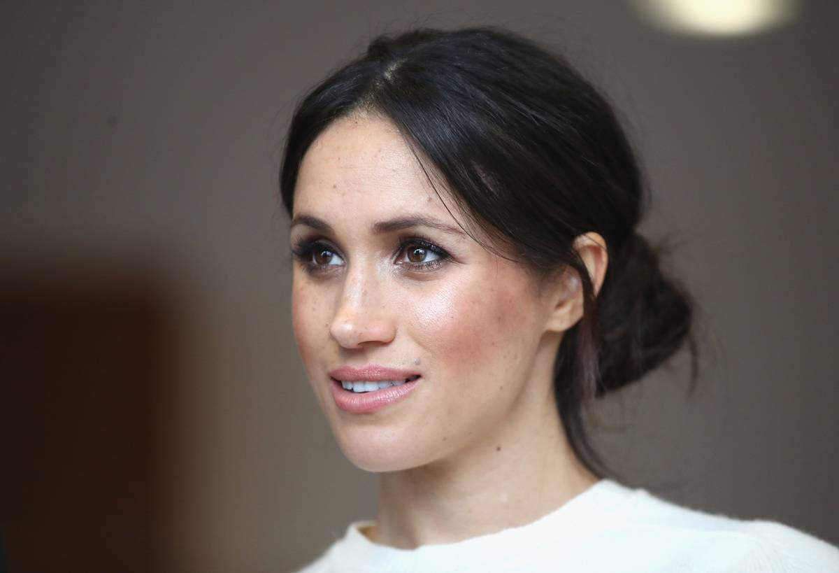 A close-up shows Meghan Markle as she visits Northern Ireland.