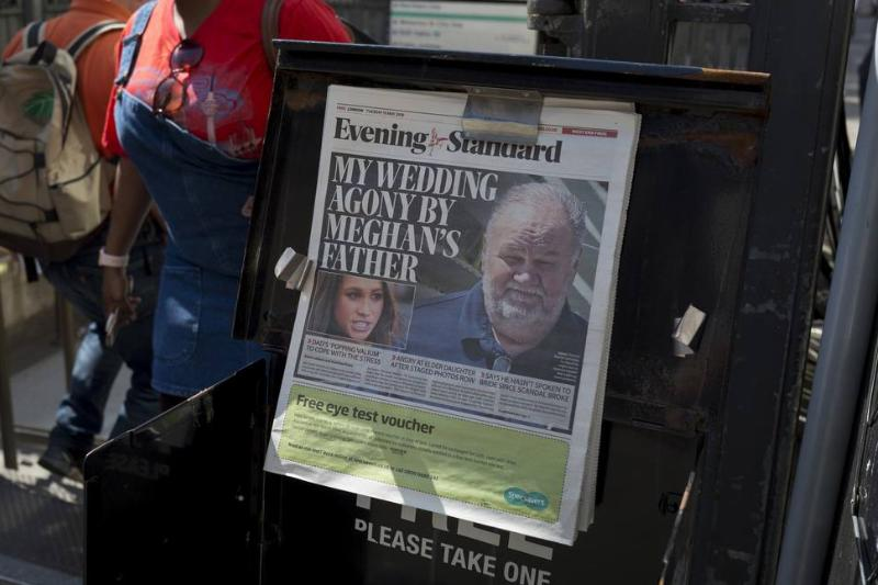 A newspaper details Meghan Markle's father not attending her wedding.