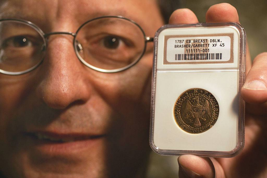 A Laguna man, Steven Contursi, holds the 1787 Brasher Doubloon