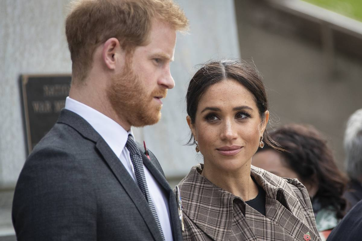 Prince Harry and Meghan talk while watching a newly unveiled Unknown Warrior Memorial.