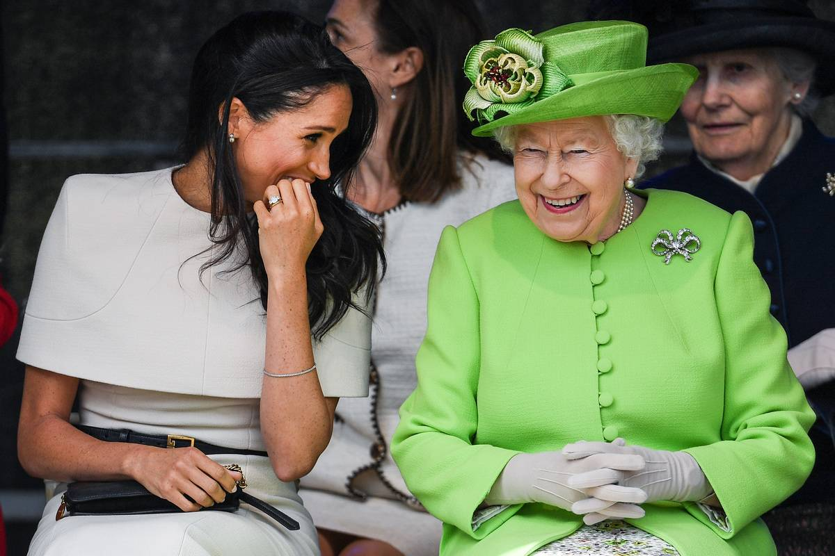Meghan Markle laughs with the Queen during a 2018 ceremony to open the new Mersey Gateway Bridge.