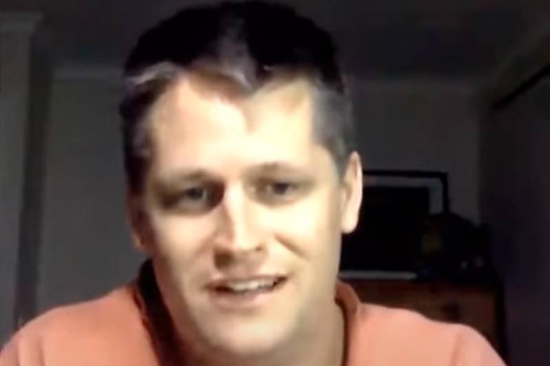 luke mcpherson wearing an orange shirt