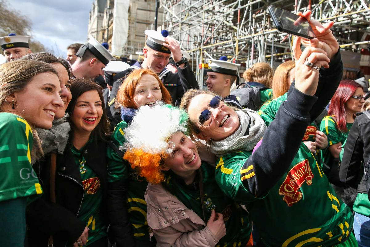 People are seen taking a selfie during the St Patrick's Day...