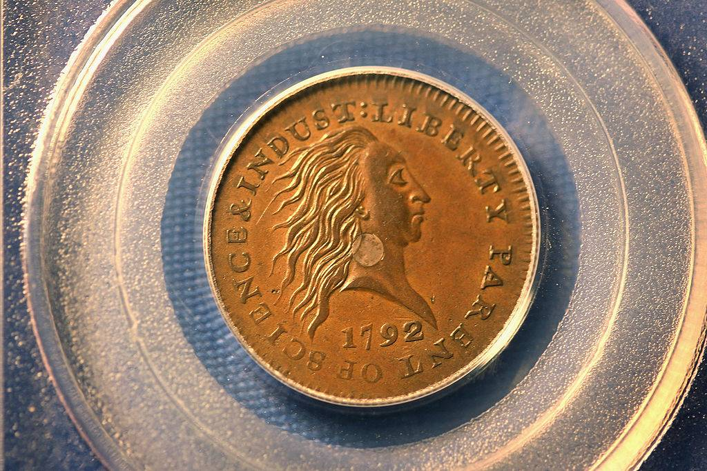 silver center cent from 1792 with front facing side of a person looking to the side