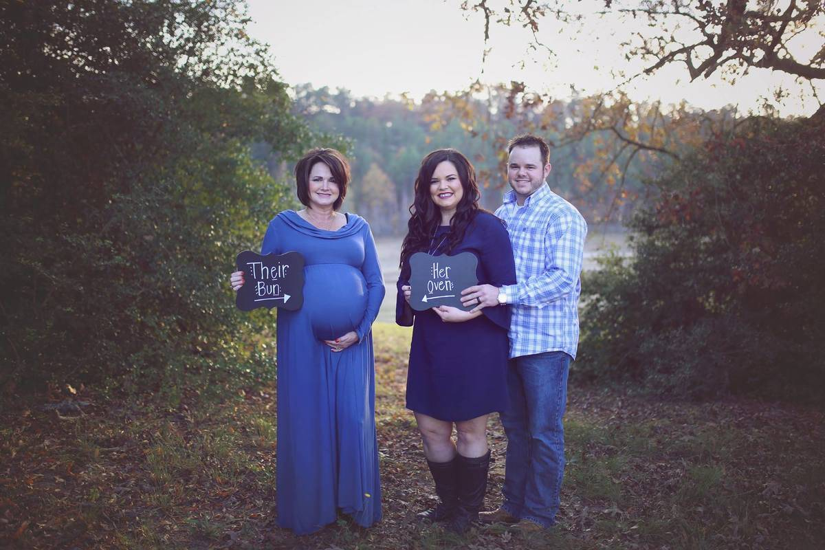 patty, kayla, and cody posing for a maternity shoot