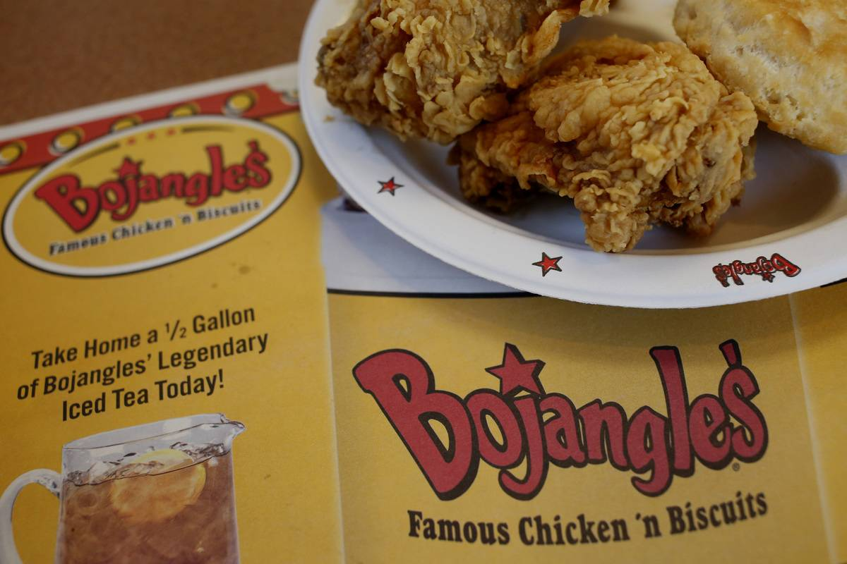 Fried chicken is placed on a Bojangle's placemat.
